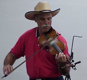 Pat Allen fiddling tunes at the April meeting